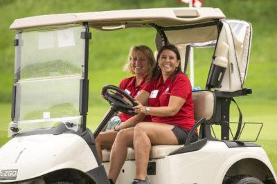 Volunteers Driving Golf Cart