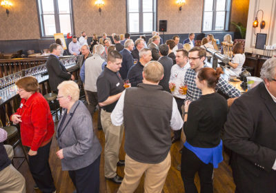 Crowd mingles in Upper Level of Taft's Ale House